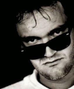 Tarantino hard at work on Inglorious Bastards, talking with Pitt